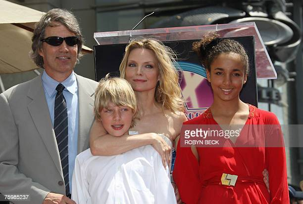 US actress Michelle Pfeiffer poses with her daughter Claudia her son John and her husband David E Kelley after Pfeiffer's star was unveiled on the...