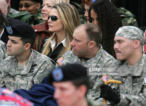 Actress Michelle Pfeiffer sits with injured soldiers during the dedication ceremony for the Center for the Intrepid at Fort Sam Houston in San...