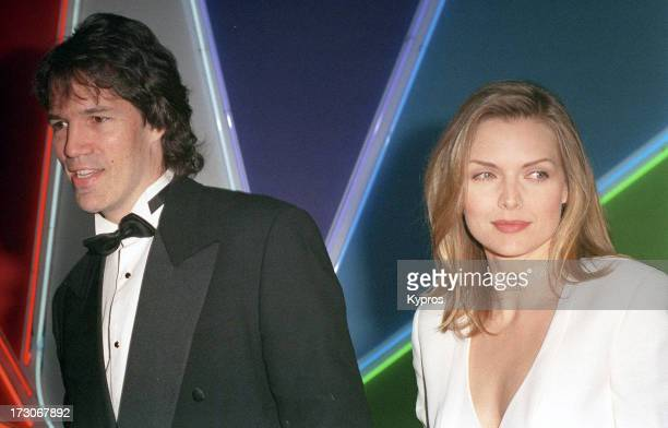 Actress Michelle Pfeiffer with her husband writer and producer David E Kelley circa 1994