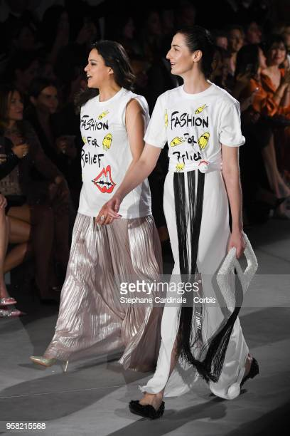 Actress Michelle Rodr'guez and model Erin O'Connor walk the runway at Fashion For Relief Cannes 2018 during the 71st annual Cannes Film Festival at...