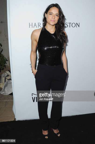 Actress Michelle Rodriguez arrives at amfAR Los Angeles 2017 at Ron Burkleâs Green Acres Estate on October 13 2017 in Beverly Hills Californi