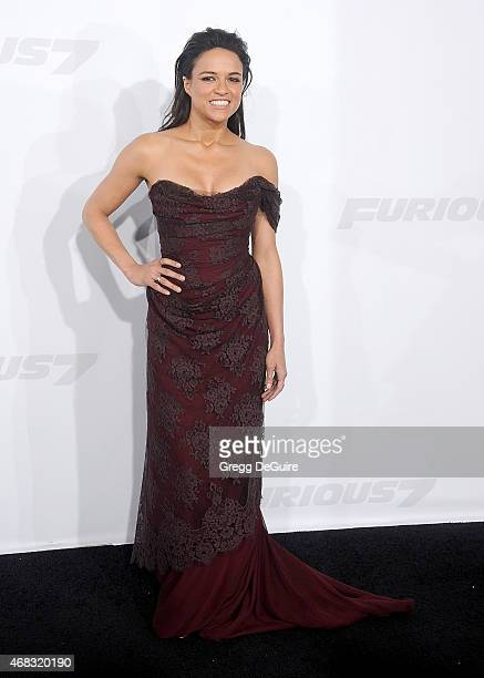 Actress Michelle Rodriguez arrives at the Los Angeles premiere of 'Furious 7' at TCL Chinese Theatre IMAX on April 1 2015 in Hollywood California