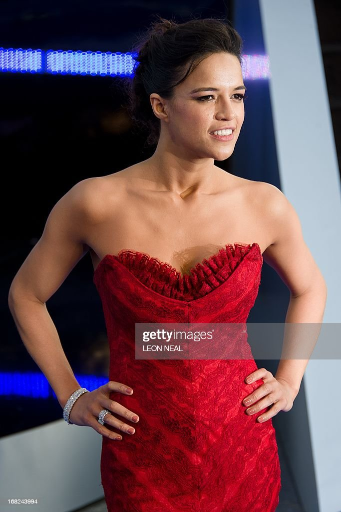 US actress Michelle Rodriguez arrives at the world premiere of 'Fast and Furious 6' at the Empire cinema in Leicester Square in central London on May 7, 2013. Starring Dwayne 'The Rock' Johnson, Vin Diesel and Paul Walker, the film is the latest film in the successful automotive action franchise. AFP PHOTO/Leon Neal