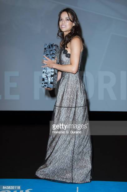 Actress Michelle Rodriguez holds the achievement tribute award she received during the 43rd Deauville American Film Festival on September 7 2017 in...