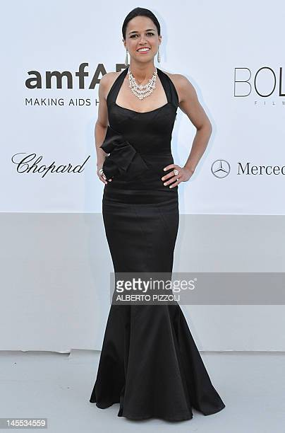 Actress Michelle Rodriguez poses as she arrives to attend the 2012 amfAR's Cinema Against Aids on May 24, 2012 in Antibes, southeastern France. AFP...