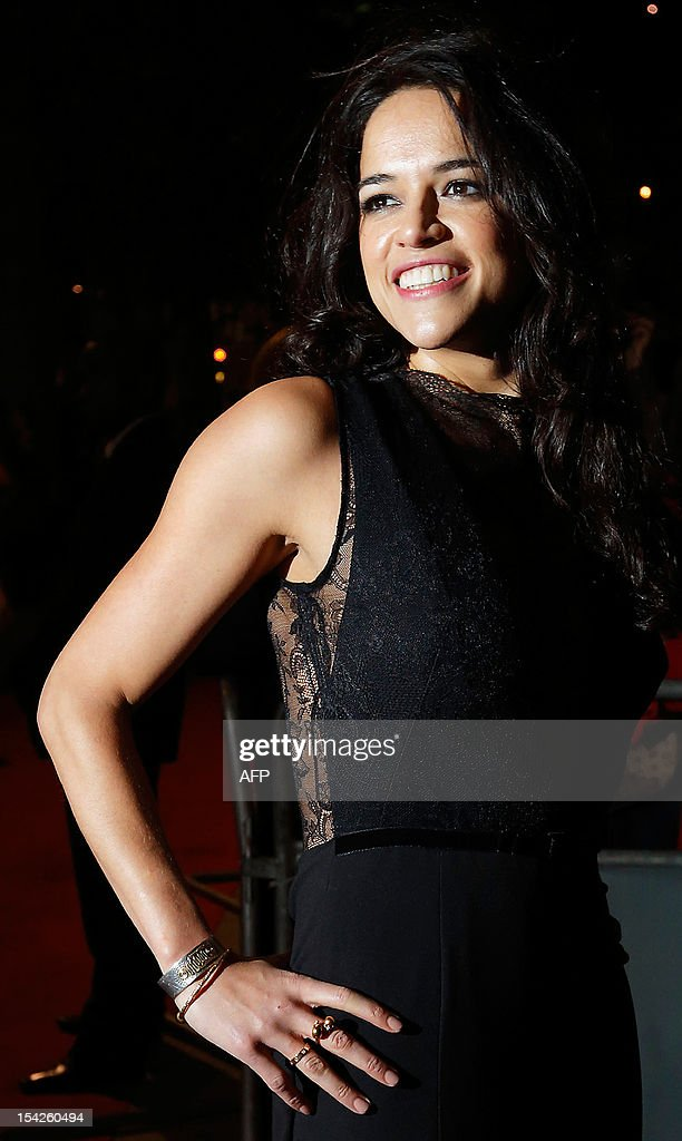 US actress Michelle Rodriguez poses for pictures on the red carpet as she arrives to attend the Hollywood Costume Dinner at the Victoria and Albert Museum in London, on October 16, 2012.