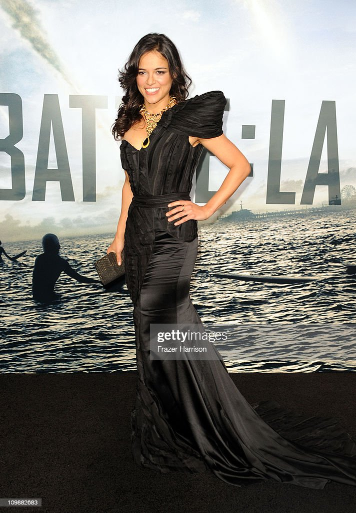 Actress Michelle Roodriguez arrives at the premiere of Columbia Pictures' 'Battle: Los Angeles' at the Regency Village Theater on March 8, 2011 in Westwood, California.