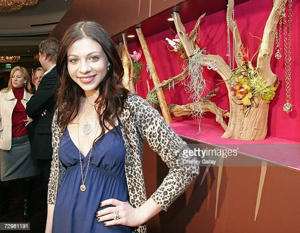Actress Michelle Trachtenberg poses next to jewelry at the Sixth Annual Awards Season Diamond Fashion Show hosted by the Diamond Information Center...