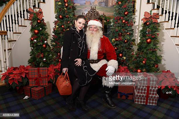 Actress Michelle Trachtenberg poses with Santa Claus as Brooks Brothers celebrates the holidays with St. Jude Children's Research Hospital on...