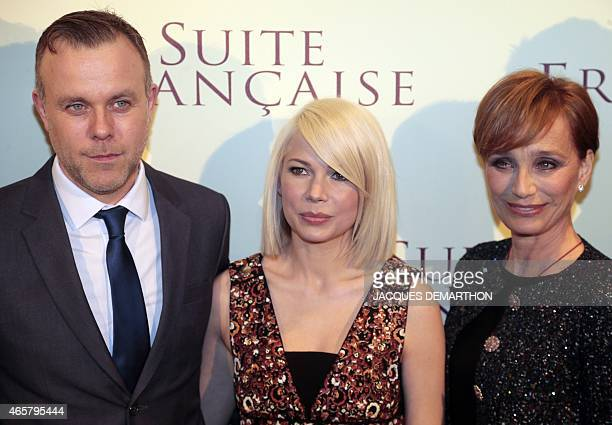 US actress Michelle Williams and British actress Kristin ScottThomas pose with British director Saul Dibb before the world preview screening of his...