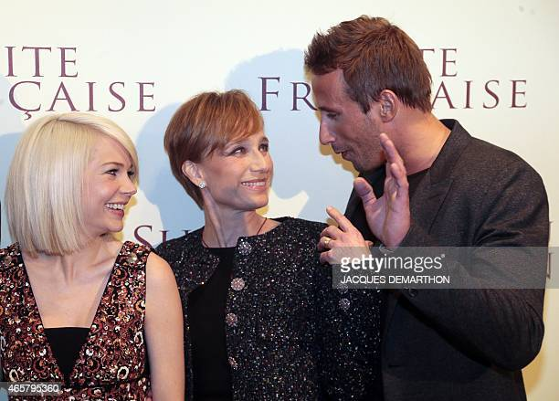 US actress Michelle Williams and British actress Kristin ScottThomas listen to Belgian actor Matthias Schoenaerts as they pose before the world...
