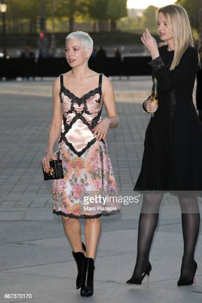 Actress Michelle Williams and Delphine Arnault attend the 'Louis Vuitton Masters a collaboration with Jeff Koons' dinner at Musee du Louvre on April...