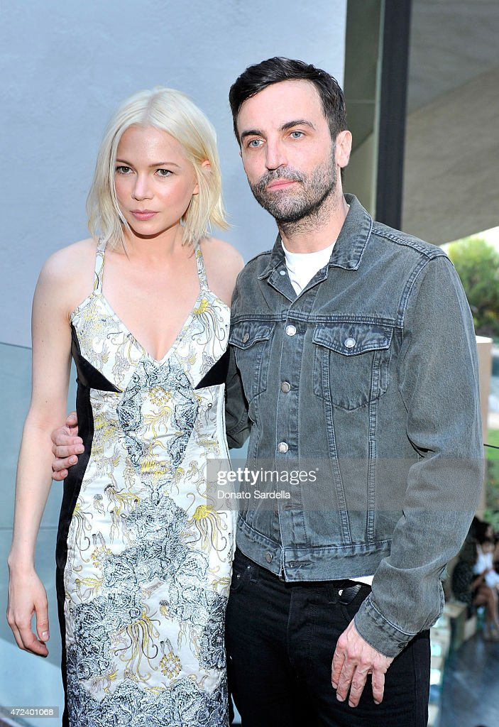 Actress Michelle Williams (L) and designer Nicolas Ghesquiere backstage at the Louis Vuitton Cruise 2016 Resort Collection shown at a private residence on May 6, 2015 in Palm Springs, California.
