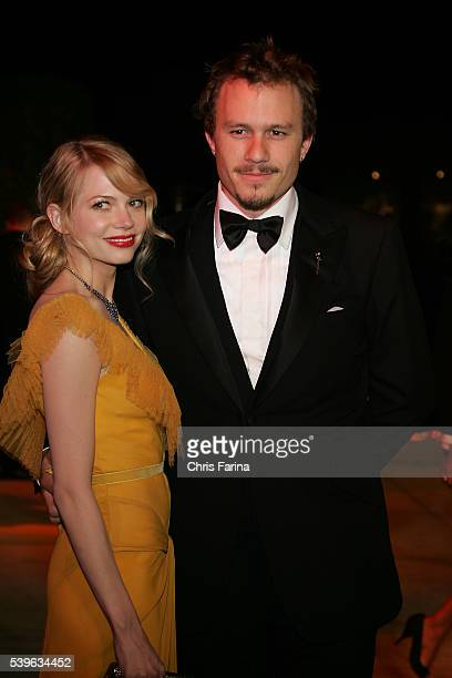 Actress Michelle Williams and partner actor Heath Ledger arrive at the Vanity Fair Academy Awards® party at Mortons restaurant Dress by Vera Wang Tux...