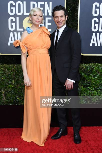 US actress Michelle Williams and Thomas Kail arrive for the 77th annual Golden Globe Awards on January 5 at The Beverly Hilton hotel in Beverly Hills...