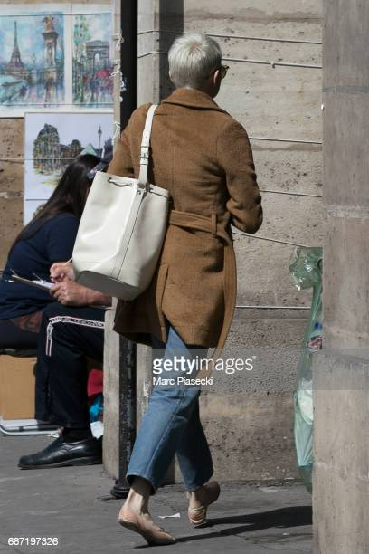 Actress Michelle Williams arrives at the 'Galignani' English bookstore on April 11 2017 in Paris France