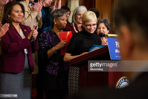 Actress Michelle Williams, center right, smiles during a news conference for Equal Pay Day in Washington, D.C., U.S., on Tuesday, April 2, 2019....