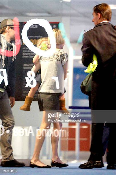 Actress Michelle Williams is seen leaving Sydney at Kingsford Smith Airport on February 10 2008 in Sydney Australia Ms Williams is pictured with...