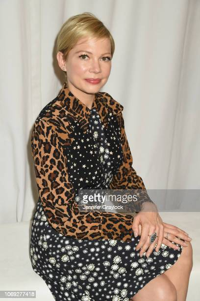 Actress Michelle Williams poses at Forevermark Diamonds Females In Focus Photo Exhibition Event on December 6 2018 in New York City