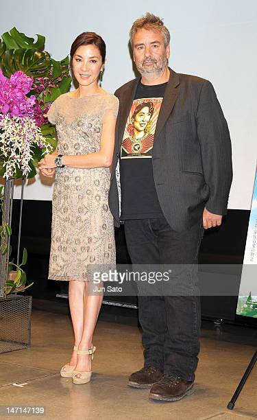 Actress Michelle Yeoh and director Luc Besson attend the premier event of 'The Lady' at Yakult Hall on June 26 2012 in Tokyo Japan The film will open...