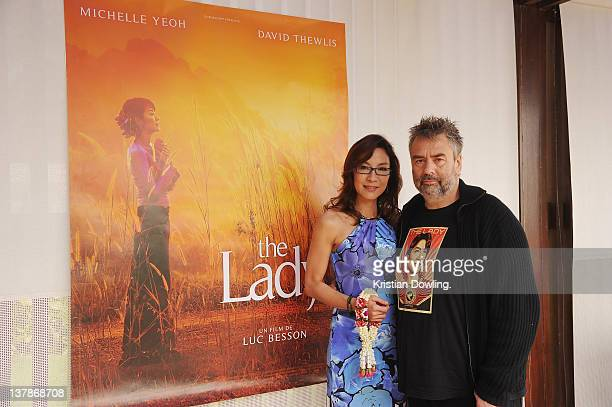 Actress Michelle Yeoh and director Luc Besson pose together to promote the film 'The Lady' ahead of the Awards night and Closing Ceremony for the Hua...