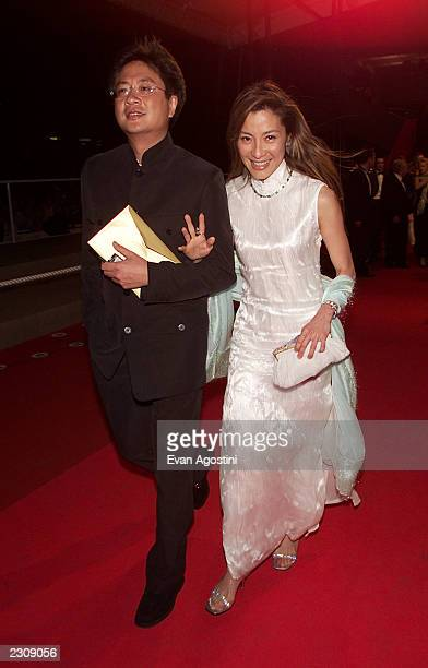 Actress Michelle Yeoh and husband Thomas Chung leave the Palais du festival after the premiere of 'Moulin Rouge' at the 54th Cannes Film Festival in...