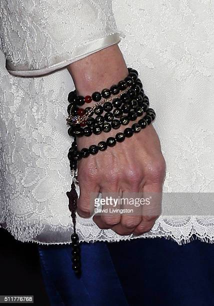 Actress Michelle Yeoh bracelet detail attends the premiere of Netflix's Crouching Tiger Hidden Dragon Sword of Destiny at AMC Universal City Walk on...