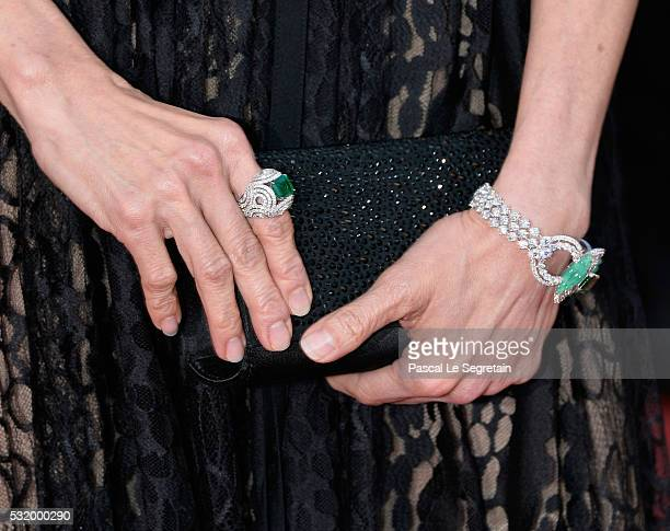 Actress Michelle Yeoh jewelry detail attends the Julieta premiere during the 69th annual Cannes Film Festival at the Palais des Festivals on May 17...
