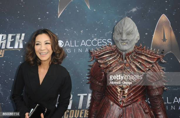 Actress Michelle Yeoh poses with a Klingon at the Premiere Of CBS's 'Star Trek Discovery' held at The Cinerama Dome on September 19 2017 in Los...