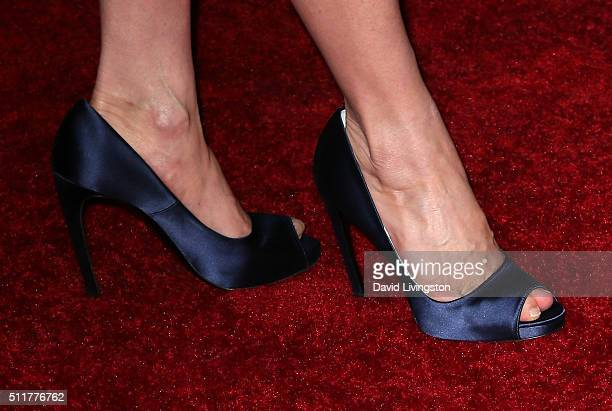Actress Michelle Yeoh shoe detail attends the premiere of Netflix's Crouching Tiger Hidden Dragon Sword of Destiny at AMC Universal City Walk on...