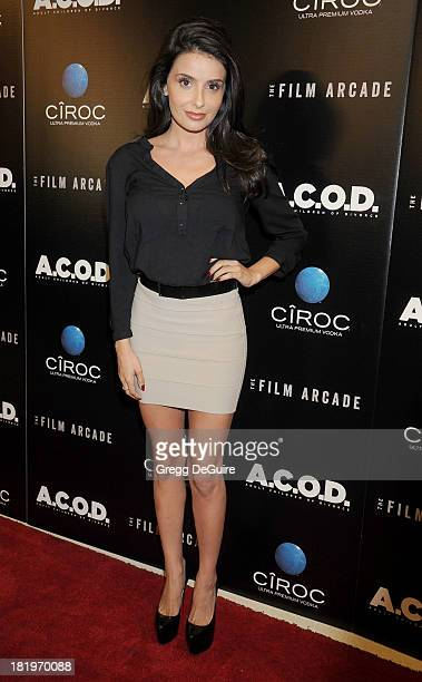 Actress Mikaela Hoover arrives at the Los Angeles premiere of ACOD at the Landmark Theater on September 26 2013 in Los Angeles California