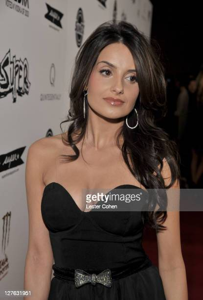 Actress Mikaela Hoover arrives at the Los Angeles premiere of Super at the Egyptian Theatre on March 21 2011 in Hollywood California