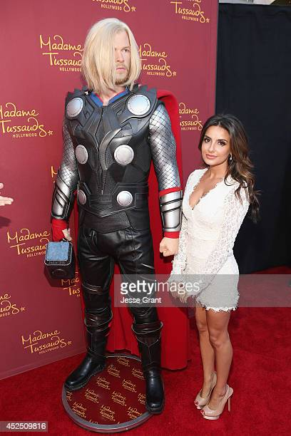 Actress Mikaela Hoover poses alongside a Madame Tussauds Hollywood MARVEL wax figure during the Guardians of The Galaxy premiere at the Dolby Theatre...