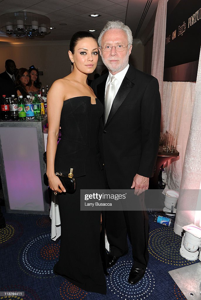 Actress Mila Kunis (L) and CNN Correspondent Wolf Blitzer attend the TIME/CNN/People/Fortune White House Correspondents' dinner cocktail party at the Washington Hilton on April 30, 2011 in Washington, DC.