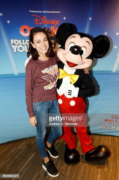 Actress Mila Kunis and Mickey Mouse attend Disney On Ice Follow Your Heart at Staples Center on December 16 2017 in Los Angeles California