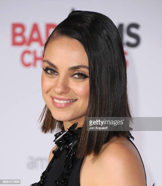Actress Mila Kunis arrives at the Los Angeles Premiere of A Bad Moms Christmas at Regency Village Theatre on October 30 2017 in Westwood California