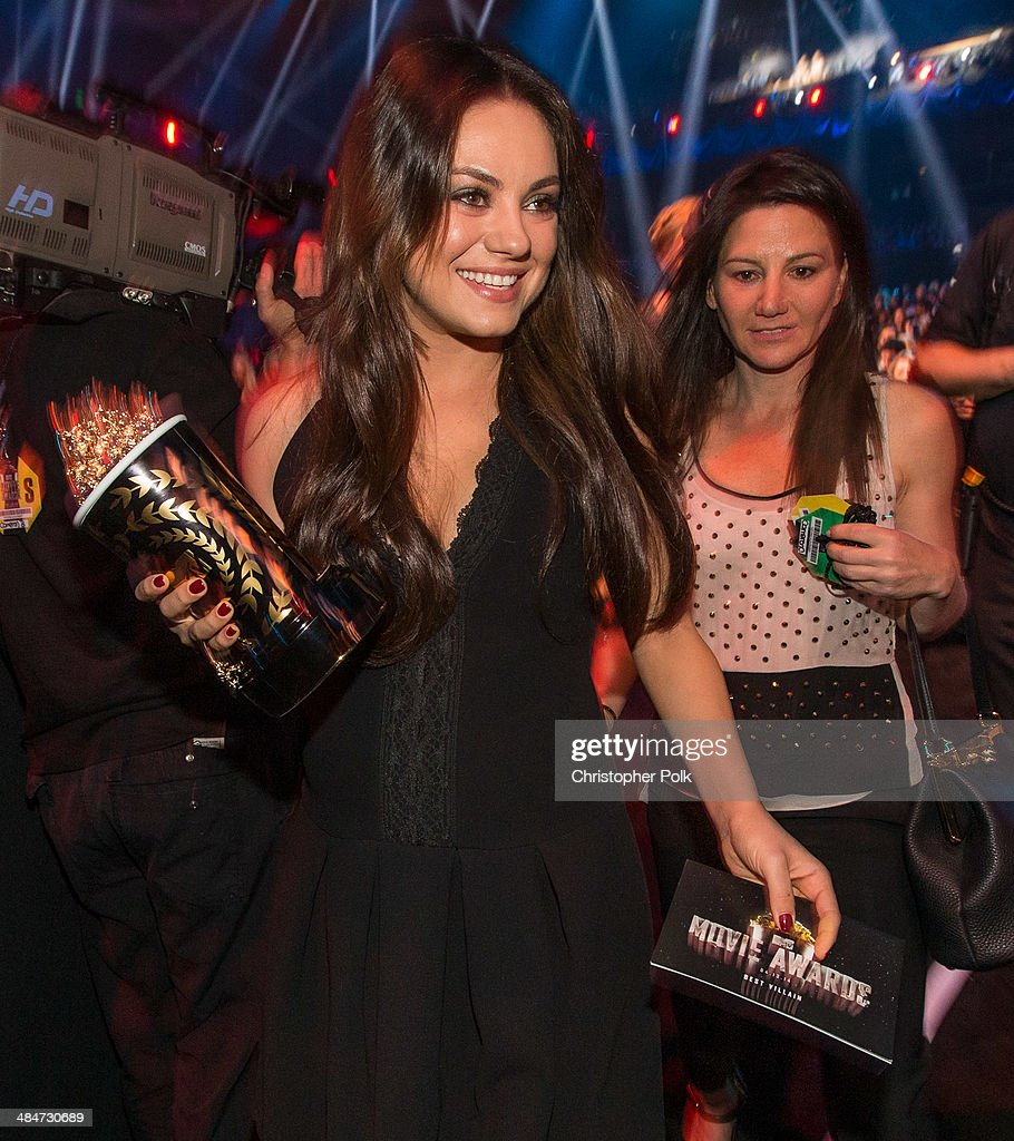 Actress Mila Kunis attends the 2014 MTV Movie Awards at Nokia Theatre L.A. Live on April 13, 2014 in Los Angeles, California.