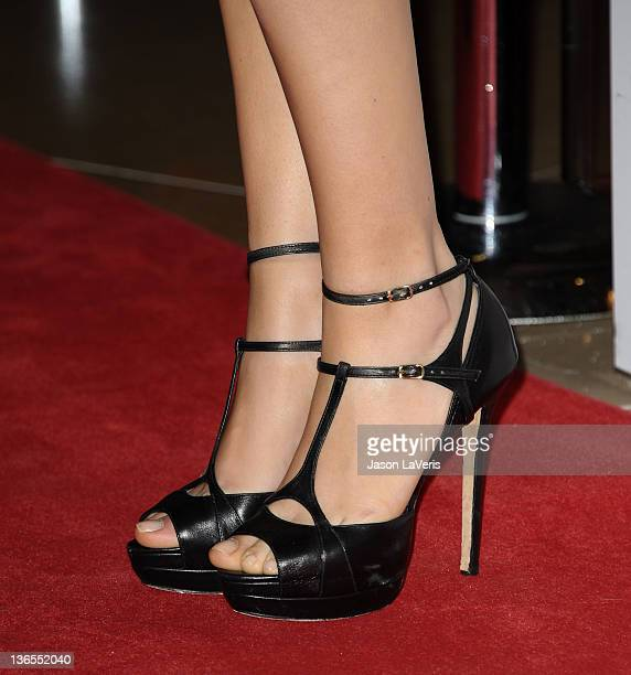 Actress Mila Kunis attends the St. Jude Children's Research Hospital 50th anniversary gala at The Beverly Hilton hotel on January 7, 2012 in Beverly...