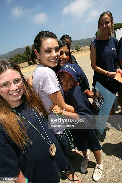 Actress Mila Kunis greets campers at Camp Heartland, a foundation dedicated to making life better for children impacted by HIV/AIDS, August 16, 2006...