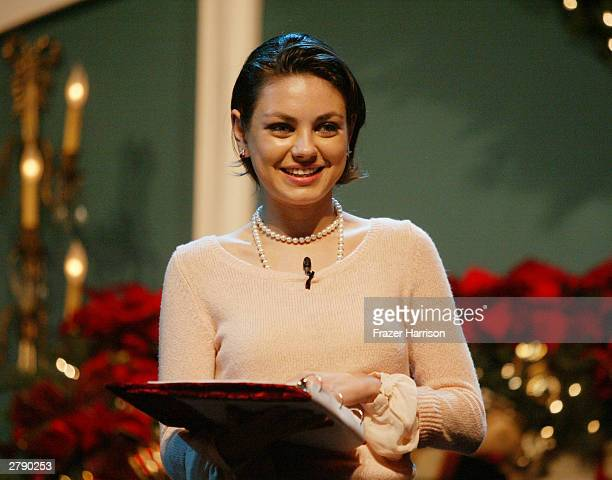 Actress Mila Kunis peforms on stage at the Church of Scientology's 11th Annual Christmas Stories Fundraiser to benefit the Hollywood Police...