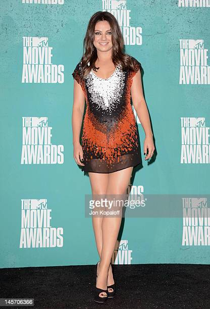 Actress Mila Kunis poses at the 2012 MTV Movie Awards Press Room at Gibson Amphitheatre on June 3 2012 in Universal City California