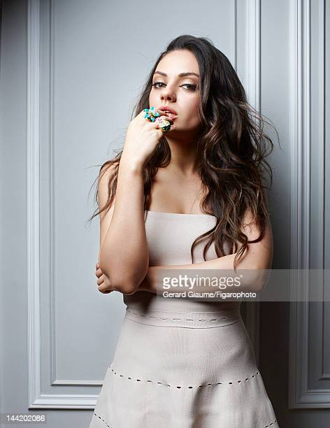 Actress Mila Kunis poses for Madame Figaro on March 1 2012 in Paris France Figaro ID 103361012 Dress and rings by Dior Makeup by Dior CREDIT MUST...