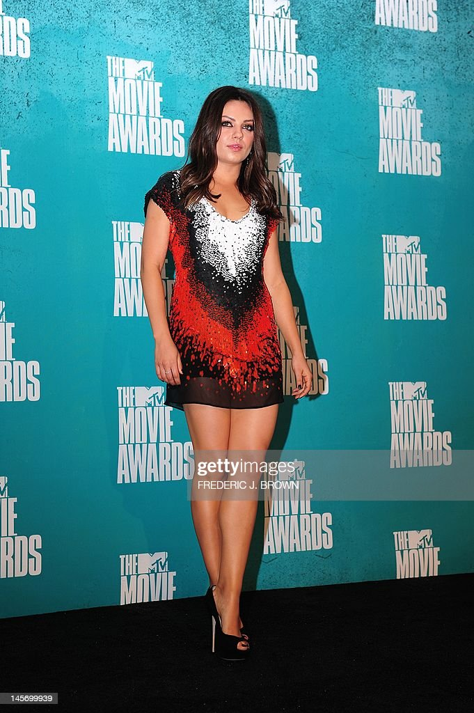 Actress Mila Kunis poses in the press room at the MTV Movie Awards at Universal Studios, in Los Angeles, California, on June 3, 2012.