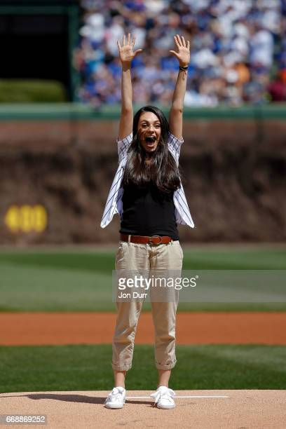 Actress Mila Kunis reacts after throwing out a ceremonial first pitch before the game between the Chicago Cubs and the Pittsburgh Pirates at Wrigley...
