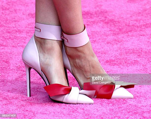 Actress Mila Kunis shoe detail attends the premiere of STX Entertainment's 'Bad Moms' at Mann Village Theatre on July 26 2016 in Westwood California