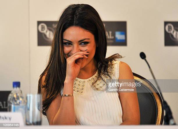 Actress Mila Kunis smiles as she talks to the media during the 'Black Swan' press conference as part of the 54th BFI London Film Festival at the...