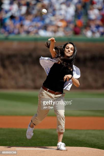 Actress Mila Kunis throws out a ceremonial first pitch before the game between the Chicago Cubs and the Pittsburgh Pirates at Wrigley Field on April...