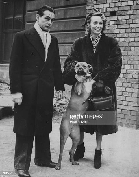 Actress Mila Parely and her husband British officer Taso Mathieson arriving at Victoria Station with their pet dog London January 25th 1948