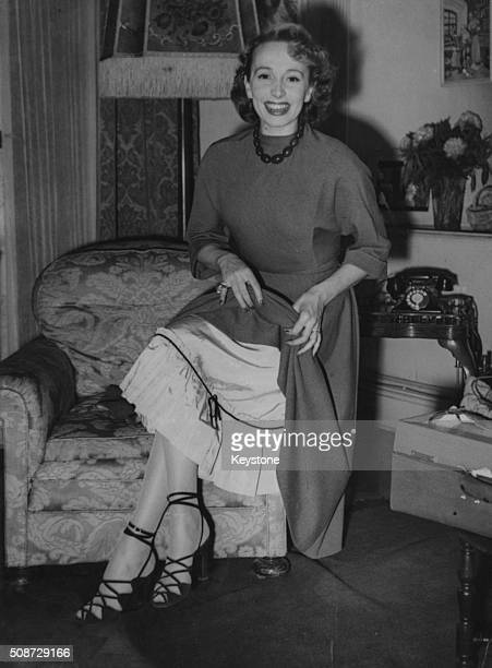 Actress Mila Parely pictured showing her petticoats in her hotel room London May 15th 1948