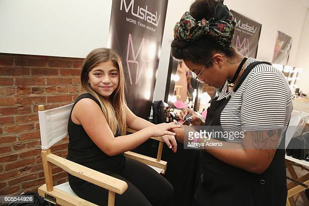 Actress Milania Giudice prepares backstage before the Tumbler & Tipsy By Michael Kuluva fashion show during Style360 NYFW September 2016 at...